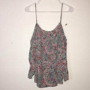 A floral strap/off the shoulder lovely shirt